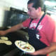 Carlos and Alexandra Terron's El Charrito Mexican restaurant business named 25th best taco in country by national food website. The Stamford couple have a small restaurant in Greenwich and a food truck in Stamford. Here Carlos is making a taco.