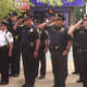 Officers of the Norwalk Police Department salute in honor of those who have died in the line of duty.