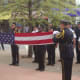 Members of the Norwalk Police Honor Guard take part in a retiring of the colors ceremony.