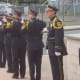 The Norwalk Police Honor Guard fires off a salute to honor the officers who have died in the line of duty.