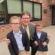 Chapel School Principal James Dhyne poses with his replacements for the day, third-grader Charlie and his brother Zachary.