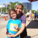 Hannah Evans and her mom Kami after finishing the 5k race Sunday in support of the Bennett Cancer Center at Stamford Hospital.