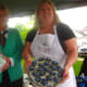 Nancy Saxe of Sweet Pierre's and Susan Schmitt of the Painted Cookie offer some of their sweets to the attendees of a Taste of Wilton on Monday.