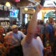The crowd at O'Neill's Pub in South Norwalk erupts into cheers Thursday upon hearing the news that the U.S. will be advancing in the World Cup.