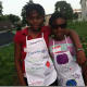 Sisters Clementine, 11, left, and Esther Voltaire, 10, right, attend the Farm to Table workshop at Fairgate Farm