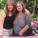 Elizabeth Beller and Annelise McCay of Wakeman Town Farm greet visitors to the chili cook-off.