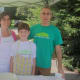 Emily, Benjamin and Robert Cohen of the Westport Electric Car Club handed out samples of a chili Benjamin prepared.