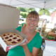 Michelle Tartaglio of Stratford holds up a pie from Oronoque Farms Bakery & Boutique of Shelton at Wilton Farmers Market.
