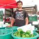 Dominic Gazy of Oxford's Gazy Brothers Farm, with some of the farm's produce at the Wilton Farmers Market.