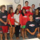 U.S. Sen. Richard Blumenthal and Stamford Mayor David Martin honor the city's lifeguards during a ceremony at Government Center on Wednesday. Brenda Moratoya, 19, was honored for saving a teenager from drowning on Aug. 6 at Cummings Beach.