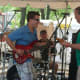 Bassist Sammy Blanchette, drummer Greg Deblasio and singer Casey Gorman right of Hubinger Street perform at SoNo Arts Celebration on Sunday. Not in picture is guitarist Matt Miklus.