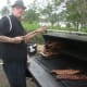 Tim Doherty of Bobby Q's smokes meat at the Blues, Views and BBQ Festival in Westport.