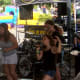 Students of the School of Rock perform at the Blues, Views and BBQ Festival.