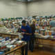 Several rooms at the Redding Community Center were filled with thousands of books for the Mark Twain Library's annual book fair.