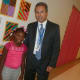 Julia A. Stark first grade student Kameiya St. Juste, stands with her principal Mark Bonasera on the first day of school Tuesday.