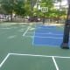 """The New Canaan Country School's new hard top on its Middle School basketball court. The school named it """"Kyle's Court,"""" after Kyle A. Markes, a Grade 6 student at the school who died in December from cancer."""