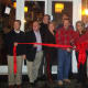 Jimmy Love cuts the ribbon on Jimmy's Southside Tavern with members of the Darien Chamber of Commerce.