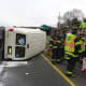 Norwalk firefighters respond after a van flipped on its side on I-95 north Tuesday afternoon.