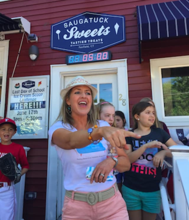 Dr. Rebecca Timlin-Scalera of Fairfield points out a participant in a charity ice cream event in Fairfield Friday that raised money for breast cancer research.