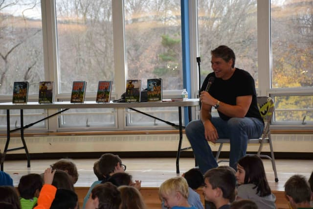 Former NFL player and sports author Tim Green offered students advice for learning to love reading and becoming kind and encouraging people.
