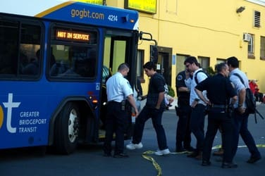 Commuters board shuttle buses after Friday's train crash near the Fairfield-Bridgeport border. Metro-North will continue bus service between Bridgeport and Stamford while the tracks are being repaired.
