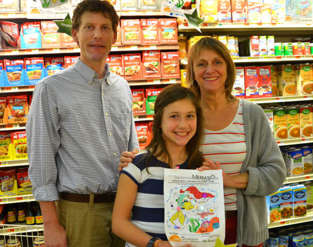 Alex Stewart, general manager of Walter Stewart's, Melody Libonati, artistic director Summer Theatre of New Canaan, and Coloring Contest Winner Ellie Luciano.