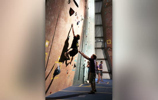 Bryce Viola, a first-year applied mathematics RIT student and 2013 national collegiate bouldering champion, attempts a bouldering route.