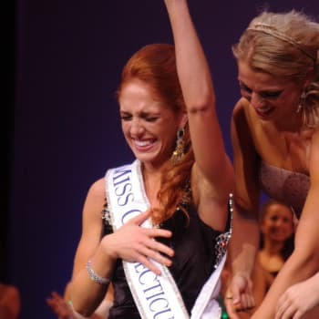 Kaitlyn Tarpey points her finger in the air after being crowned Miss Connecticut on Saturday night.