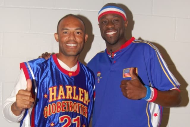 Harrison resident Mariano Rivera, seen here with Special K Daley, was drafted by the Harlem Globetrotters Tuesday.