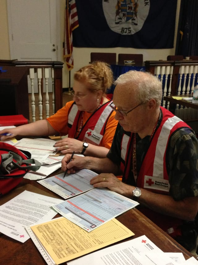 American Red Cross Volunteers Fred and Nancy Stein, of Chappaqua, and three other volunteers assisted the 15 people displaced by the June 24 fire in Mount Kisco.