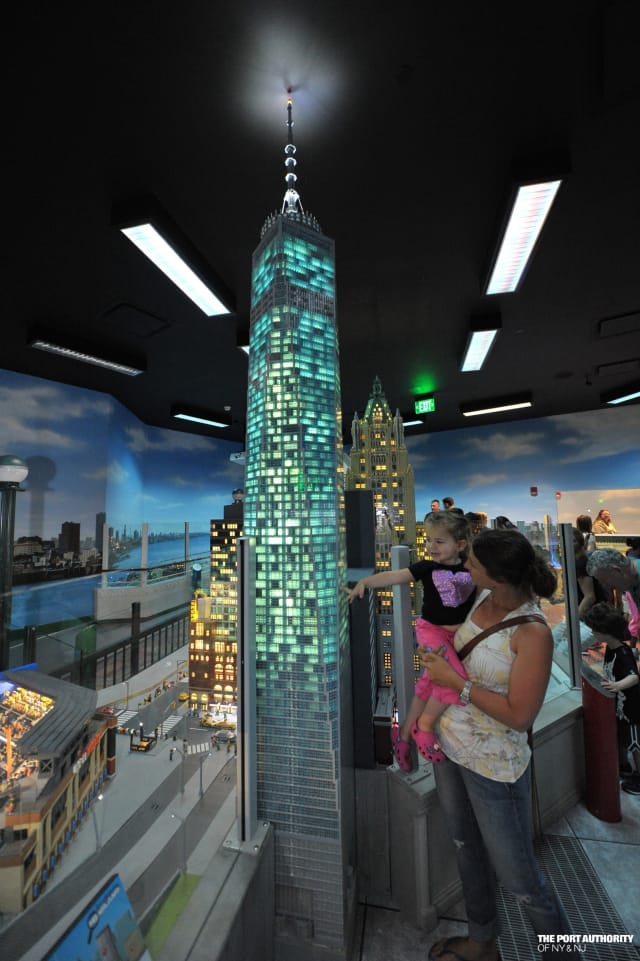 Guests at LEGOLAND Discovery Center Westchester watch a LEGO replica of One World Trade Center light up following a special ceremony unveiling the model last month.