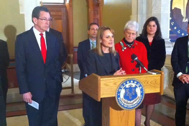 Evonne Klein, commissioner of the state Department of Housing, speaks as Gov. Dannel Malloy stands to her left.