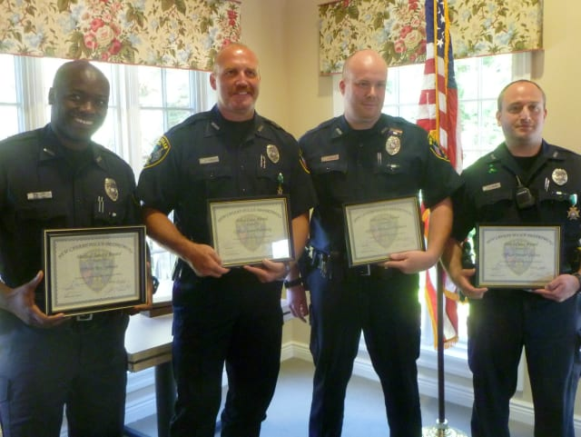 From left: Officers Rex Sprosta, Scott Humberg, Michael O'Sullivan, and Daniel Gulino were honored for their bravery shown in incidents earlier this year.