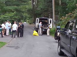 A suspicious substance is removed from a Darien residence by Connecticut State Police. Preliminary testing will be conducted. The scene was released to the FBI, Darien police said.