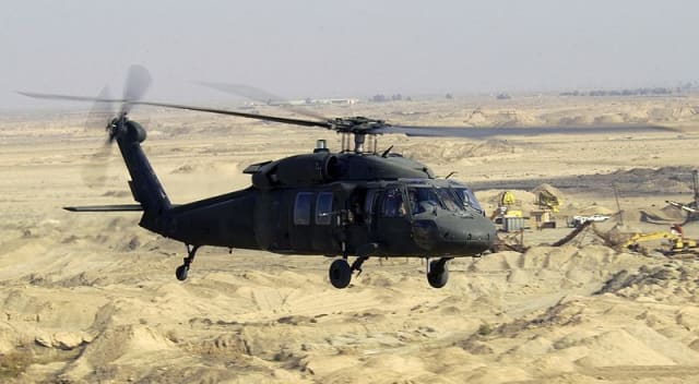 A Blackhawk helicopter flies a low-level mission over Iraq in January 2004. Blackhawk helicopters are assembled in Stratford, Conn.