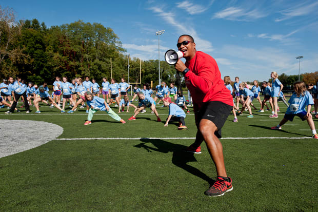 Wilton students trained with former NFL running back Vince Workman on Monday for the Save the Children's World Marathon Challenge at Wilton High School.