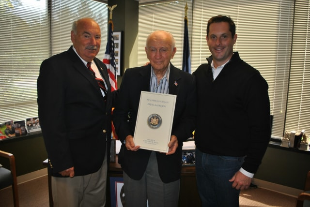 Sen. Greg Ball, right, recently honored Mount Kisco's John Hvisch, center, with the induction into the Veterans' Hall of Fame. Mount Kisco Mayor Michael Cindrich, left, was on hand for the event.
