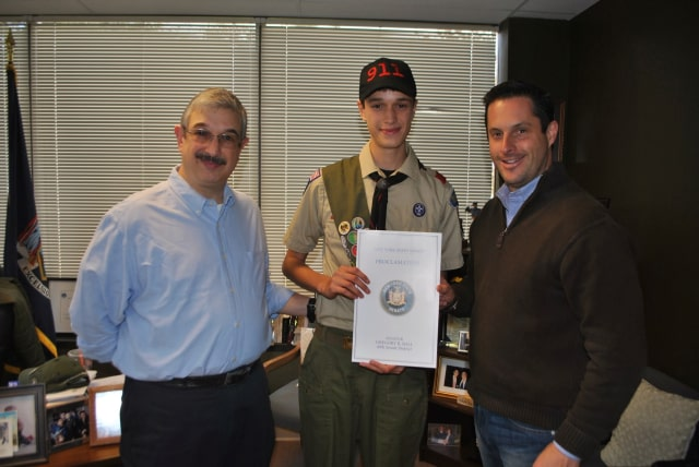 Yorktown resident Erik Santini, center, recently received a New York State Proclimation from Sen. Greg Ball for achieving the rank of Eagle Scout.