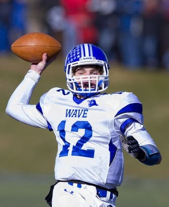 Darien quarterback Silas Wyper throws to a receiver during the Blue Wave's win over New Canaan on Thanksgiving. The two teams will face off Saturday in the Class L final.