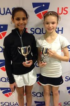 Nina Mital of West Harrison and Marina Stefanoni of Darien show trophies they won at the U.S. Junior Championships in New Haven. They play squash out of Chelsea Piers Connecticut in Stamford.