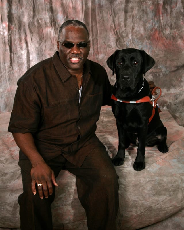 Cecil and Guiding Eyes dog Orlando.