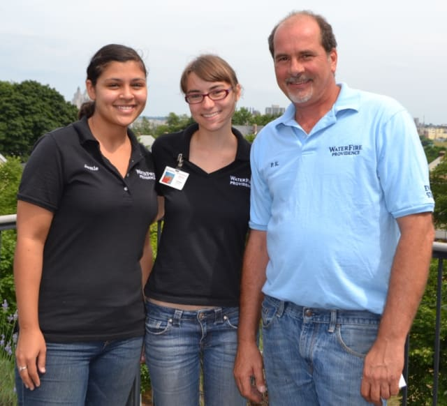 Chelsea Kryspin, center, poses with Jamie Leiva, Special Events assistant at WaterFire Providence ,left, and Paul Kochanek, director of Events & Operations at WaterFire Providence.