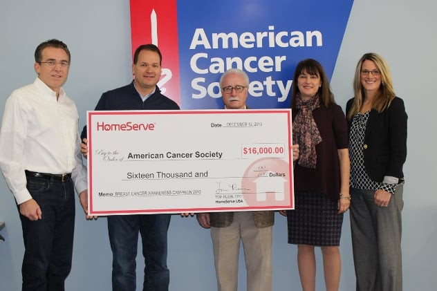 Members of the HomeServe team presented a check for $16,000 to the American Cancer Society.