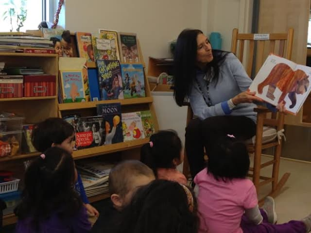 Maryellen Baker of Ridgefield, a volunteer with United Way's Ready, Set, Let's Read! program, reads to preschool children at Head Start of Northern Fairfield County.