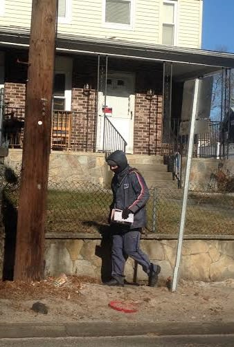 A mailman in Danbury knows to bundle up on a frigid and windy Tuesday.