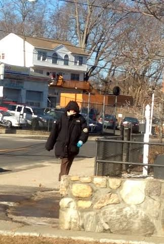 A Danbury pedestrian is bundled up Tuesday as bitter winds blow.