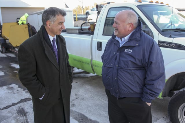 State Sen. Carlo Leone speaks with Bruce More Sr. while visiting his Stamford family-owned business, Eastern Land Management.