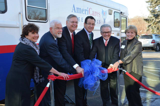 (Left to right) Stella Smith of Quest Diagnostics, David Smith of Stamford Hospital, Stamford Mayor David Martin, Governor Dannel Malloy, Americares CEO Curt Welling and AmeriCares Free Clinics Executive Director Karen Gottlieb cut the ribbon.