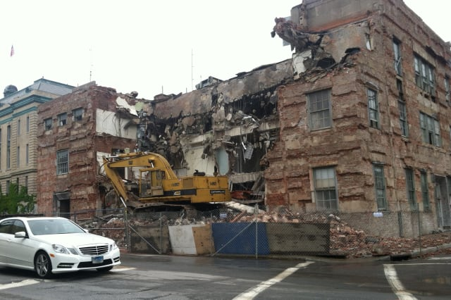 Crews have demolished the old central fire station in Greenwich. A new facility is set to be operational by 2016.