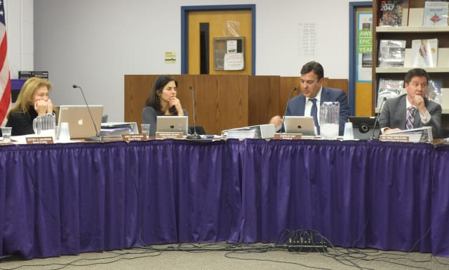 Katohan-Lewisboro School Superintendent Paul Kreutzer (right) talks redistricting with the school board.